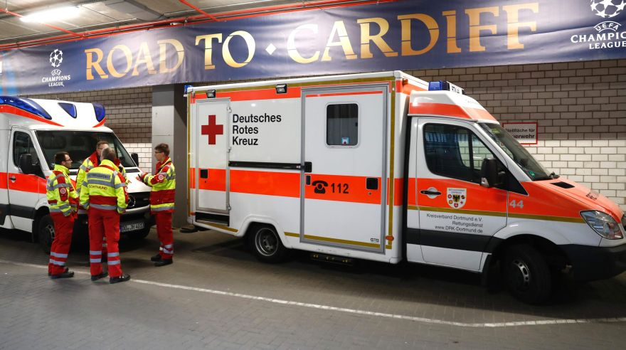 Ambulances are pictured inside stadium after the team bus of Borussia Dortmund had some windows broken by an explosion some 10km away from the stadium prior tothe UEFA Champions League 1st leg quarter-final football match BVB Borussia Dortmund v Monaco in Dortmund, western Germany on April 11, 2017. / AFP / Odd ANDERSEN
