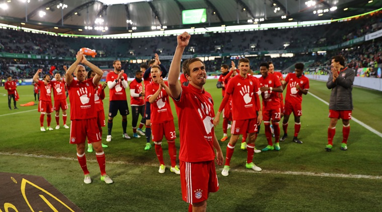 Football Soccer - VFL Wolfsburg v Bayern Munich - Bundesliga - Volkswagen Arena, Wolfsburg, Germany - 29/4/17 Bayern Munich's Philipp Lahm celebrates after the match after winning the Bundesliga   Reuters / Kai Pfaffenbach Livepic DFL RULES TO LIMIT THE ONLINE USAGE DURING MATCH TIME TO 15 PICTURES PER GAME. IMAGE SEQUENCES TO SIMULATE VIDEO IS NOT ALLOWED AT ANY TIME. FOR FURTHER QUERIES PLEASE CONTACT DFL DIRECTLY AT + 49 69 650050.